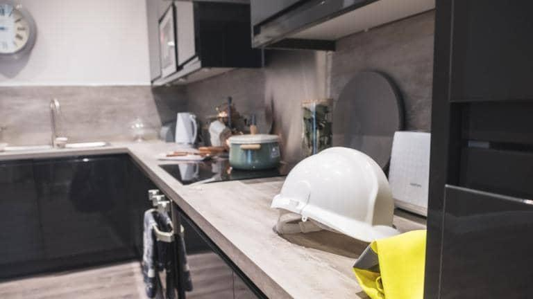 A hard hat on a kitchen worktop.