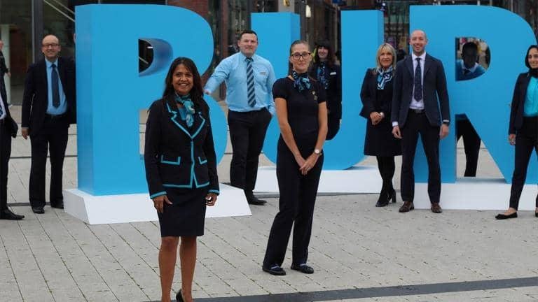 A group of Barclays employees standing outside.