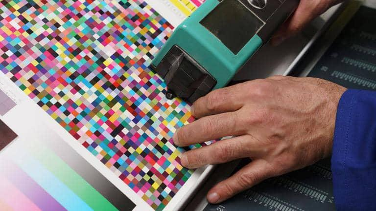 A person checks the colour profile of a printer