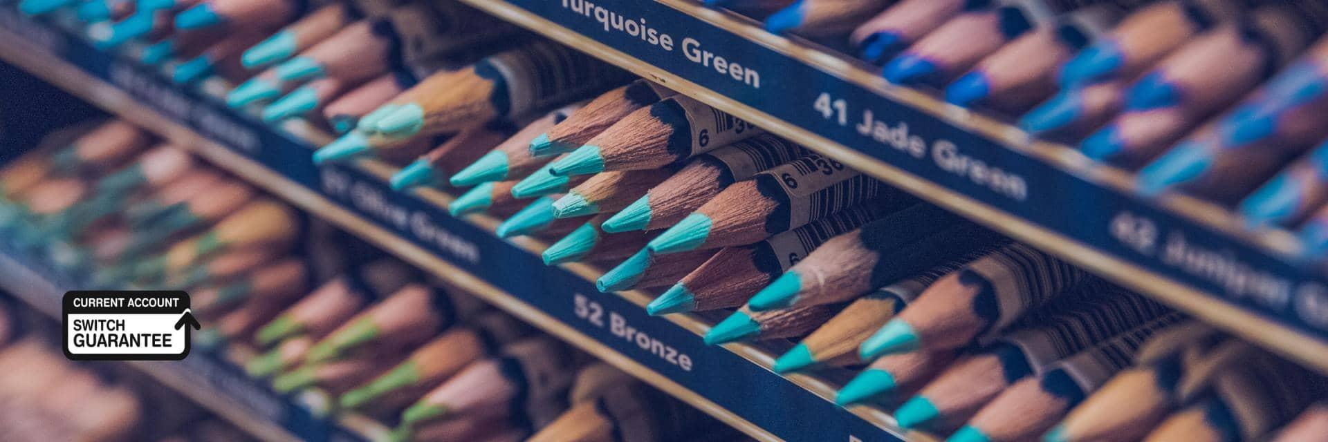 Coloured pencils arranged in a shop display