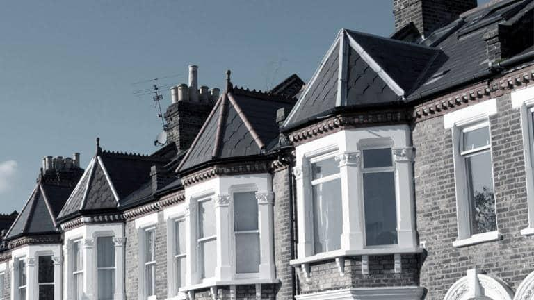 A row of terraced houses with bay windows