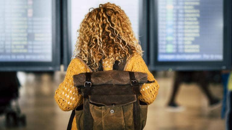 A woman wearing a backpack