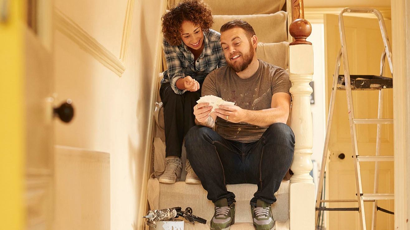 couple sitting on the stairs of their home
