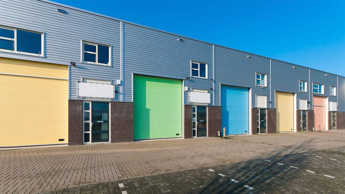 Exterior industrial business units with coloured roller shutters