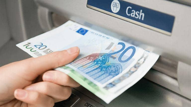 An ATM machine issuing 120 euros in cash to a customer