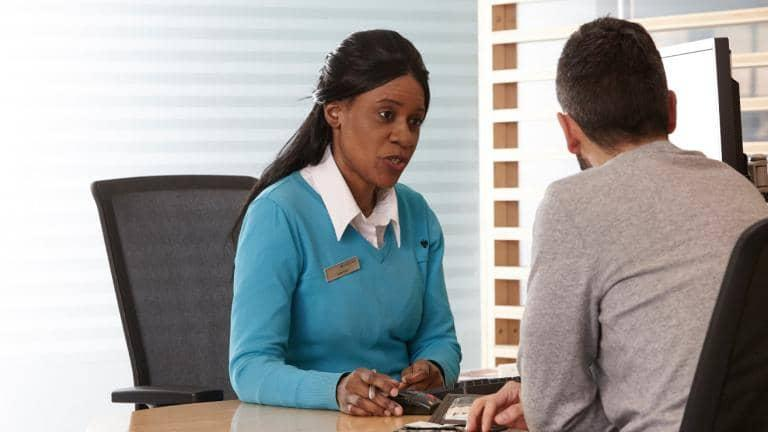 A Barclays colleague meets with a customer in branch