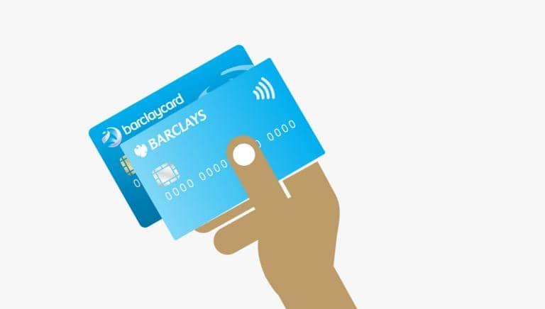 Card not working, hand holding a Barclaycard credit card and a Barclays debit card