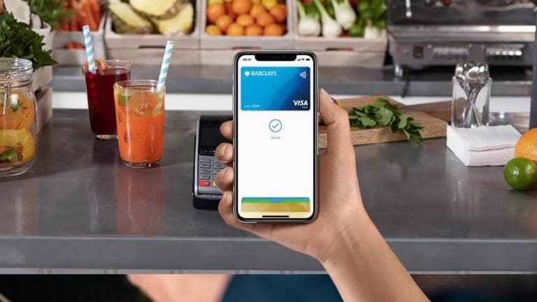 A phone screen using Apple Pay with a Barclays card to make a payment.