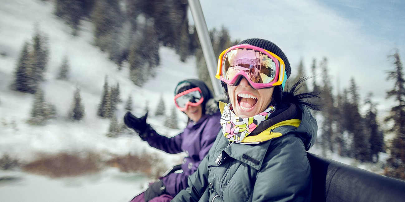 Two skiers on a chair lift